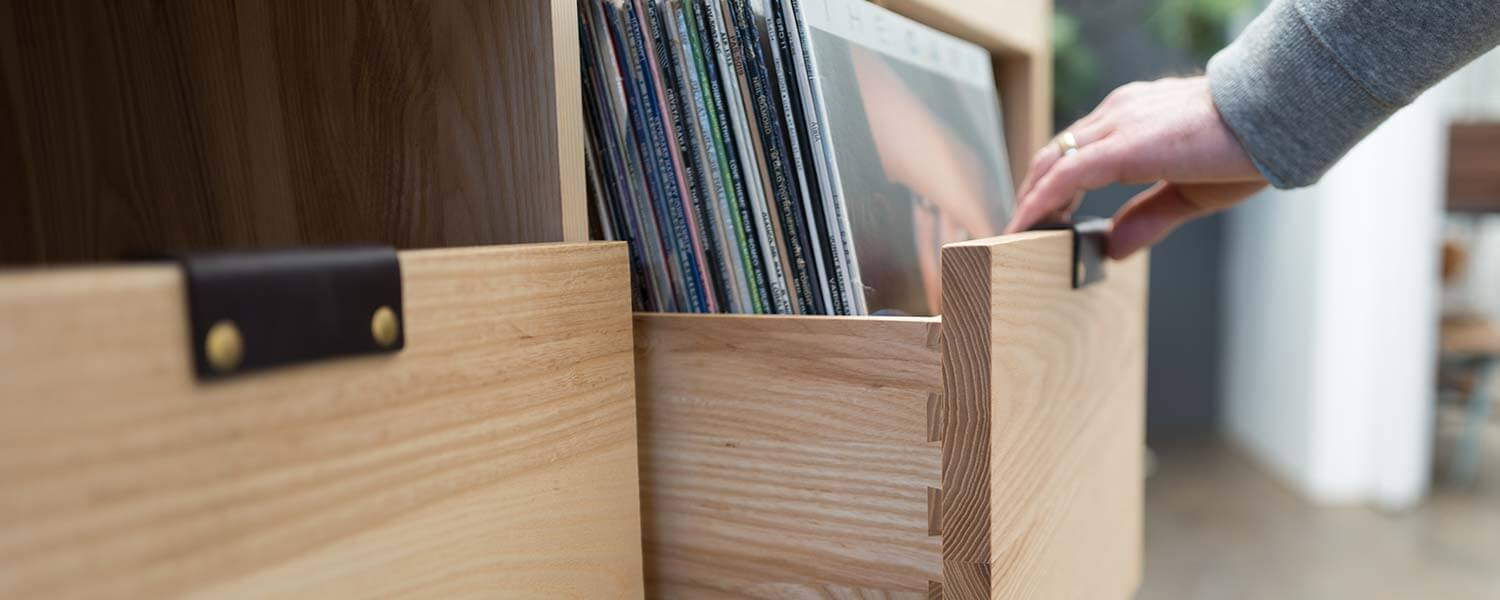 Dovetail Modern Vinyl Storage with pull out vinyl storage cabinets holding 90 LPs. Crafted with light-colored North American hardwood.