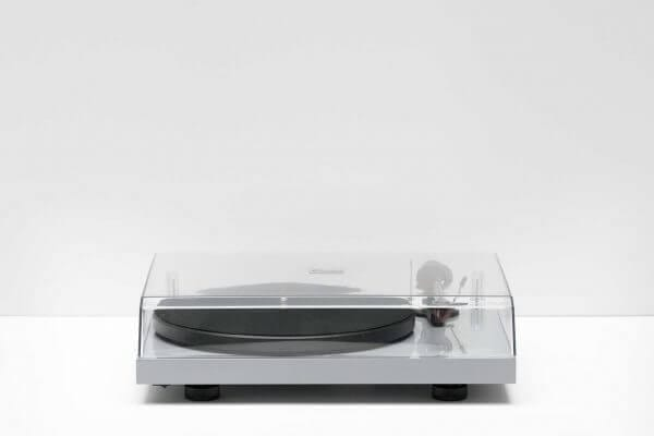 Pro-Ject Debut Carbon DC Turntable closed overhead clear glass lid. 6th Generation Hi-Fi classic stainless steel in a light-grey theme. It stands at 16.3 inches tall and 4.6 inches wide.
