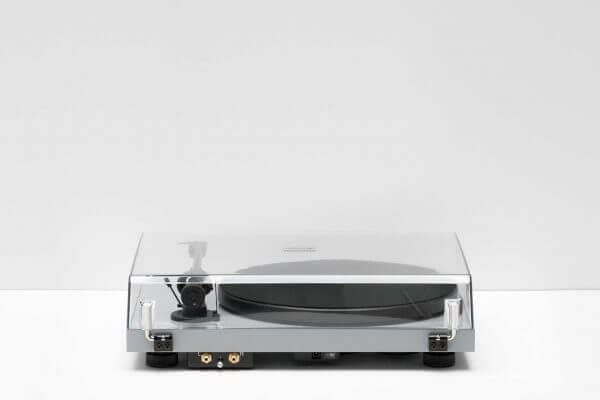 Pro-Ject Debut Carbon DC Turntable closed overhead clear glass lid rearview. 6th Generation Hi-Fi classic stainless steel in a light-grey theme. It stands at 16.3 inches tall and 4.6 inches wide.