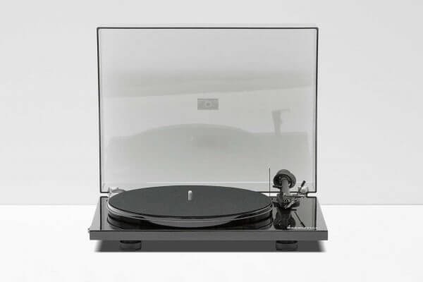 Pro-Ject Debut Carbon DC Turntable. 6th Generation Hi-Fi classic stainless steel in a dark black theme. It stands at 16.3 inches tall and 4.6 inches wide.