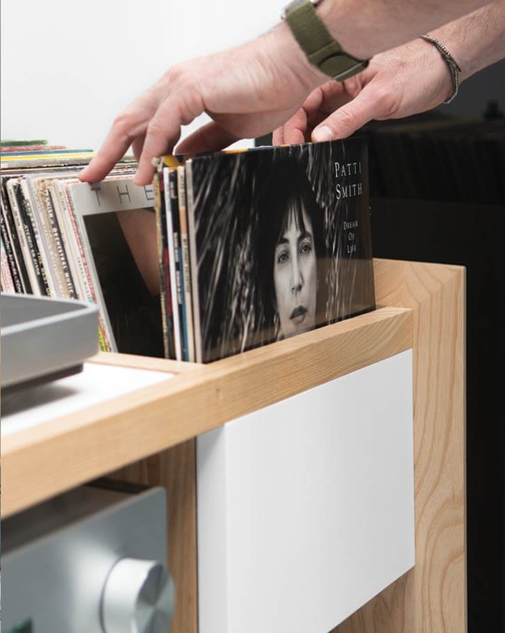 Unison Turntable Stand for Vinyl Storage. Close view of flip-style LP storage featuring light-wood themes.
